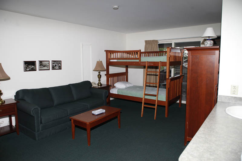 Room with couch and bunk beds
