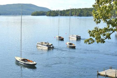 Sailboats moored on Lake George