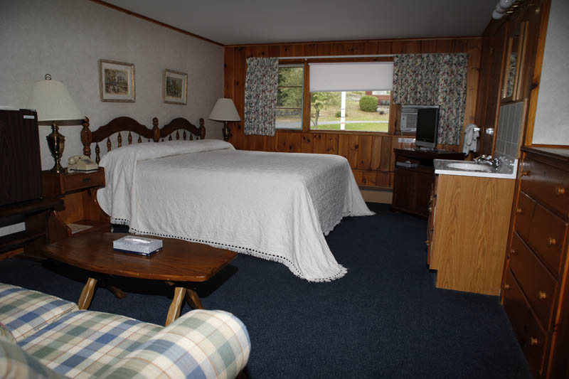 Adirondack Main Lodge room with queen bed and sink