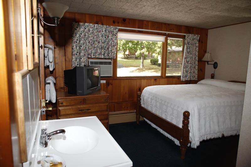 Adirondack Lodge room with vanity and queen bed