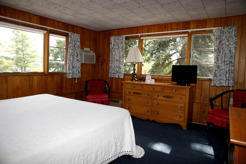 Wood paneled room with wood furniture