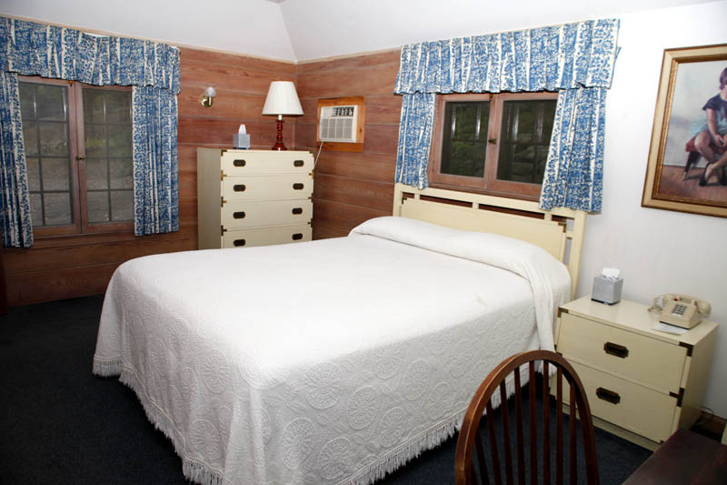 Adirondack Cottage room with bed and furniture